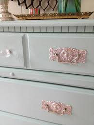 the pulls were originally brass but i wanted to spray paint them silver the gold pull looked really chic and reminded me of my favorite kitchen island