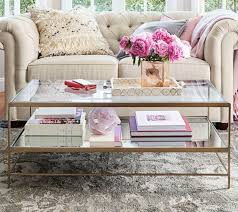 styling your coffee table sets the vibe for your entire living room image pottery barn