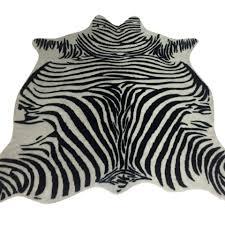 harp finial zebra hide rug
