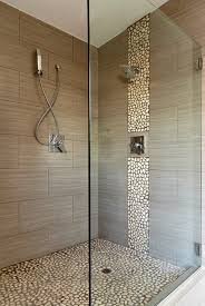 Master walk in shower modern bathroom love the river rock on the wall and  tile selection. Texun Builders by MyohoDane