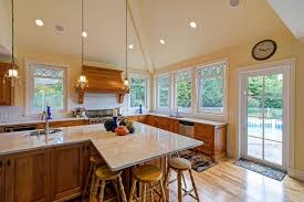 glass windows and cream wall kitchens with no windows yellow marble countertop high silver bar stools black chairs