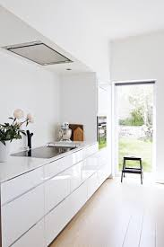 high gloss linoleum kitchen marvelous white with stunning ceiling lamp above bar counter and stool near