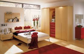 bedroom design for couples. Amazing Bedroom Design Ideas With Wide Bed And Wooden Nightstands Near High Wardrobe Cabinets For Couples I