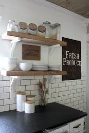 The Chic Technique: DIY Farmhouse Kitchen Makeover. Love the reclaimed wood  open shelving, subway tile, black granite counters, wood ceiling.