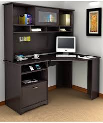 black wooden corner desk with drawers and shelves on brown rug furniture plus white wall