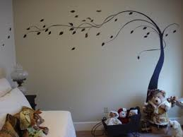 i m having so much fun leaning about painting on walls this is a simple tree that i painted freehand on the wall