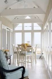 sunroom dining room. Beautiful Dining Sunroom Dining Room Sunroom Shelves Dining Room Traditional With Gold  Curtain Holdbacks Find This Pin And In