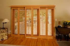 faux wood shutters on sliding door leading to back porch