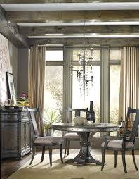 hand carved dining table timeless interior designer: hooker furniture vintage west in round dining table w in leaf