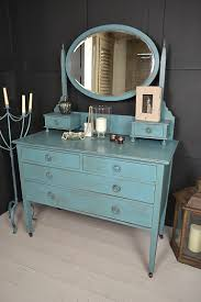 This vibrant vintage dressing table has 6 drawers and large moveable mirror.  We've