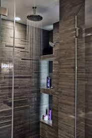 modern shower head recessed bathroom lighting. Round Rain Shower Head Installed In The Bathroom With Faux Stone Wall Tiles Modern Recessed Lighting E