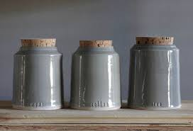 grey ceramic canisters with wooden lids