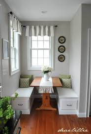 whitney via remodelaholic teaches us how to makeover a dining room with her built in banquette wainscoting and even how to pick the right paint color