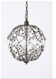 this wrought iron chandelier with crystal leaves on the ends is like a very grown up version of lights which i still sometimes want to hang in
