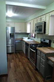 white kitchens with dark wood floors white kitchen cabinets dark tile floor off white kitchen cabinets