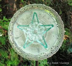 diy repurposed glass plates used in plate flower for garden decor