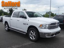 PRE-OWNED 2015 RAM 1500 4WD CREW CAB 140.5