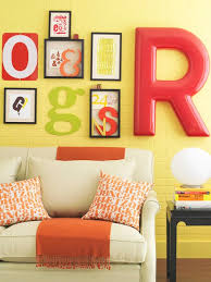 using letters is also an interesting idea for a picture wall because decorating walls with pictures