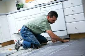 how to remove tile from concrete floor man laying tile in a kitchen removing linoleum tile