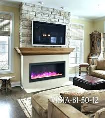 tv above fireplace above electric fireplace sierra flame vista electric stone wall wood mantel fireplace ideas