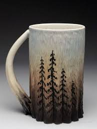 Dow Redcorn Mug at MudFire Gallery. It is made on wheel thrown, hand carved  and other interesting techniques.
