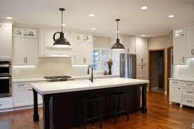 2 oil rubbed bronze kitchen pendant lighting over large kitchen island for modern white kitchen interior