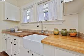 cottage kitchen with mexican tile backsplash european cabinets john boos countertops