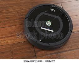 irobot roomba 770 household vacuum cleaning robot on hardwood floor stock photo