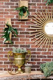 outdoor wall decor front of house patio design with copper garden accents and succulents