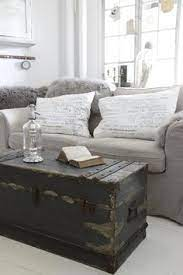 Bone inlayed furniture is really popular right now.not with people like us, cause we're cheap, but with people that have money to throw around. 16 Old Trunks Turned Coffee Tables That Bring Extra Storage And Character Living Room Diy Home Decor Home