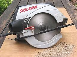 hacksaw in use. portable electric circular saw. hacksaw in use