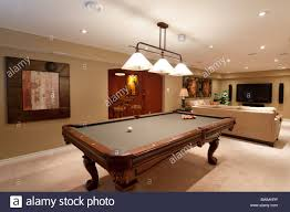 basement pool table.  Basement Basement In Luxury Residential Home With Pool Table And Television On Pool Table
