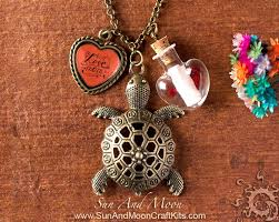 antique brass pendant making kit message in a bottle turtle pendant heart charm with glass