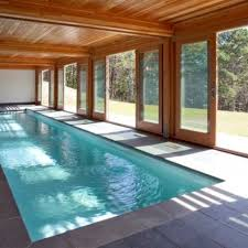 indoor swimming pool with doors that open to outside