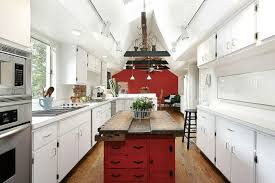 white galley kitchen with narrow red rustic kitchen island