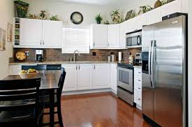 greenery above kitchen cabinets ideas in l shaped kitchen cabinets it s one of the most popular on home decorating these images posted under greenery