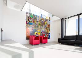 white house interior design with black sofa red sofa and creative painting
