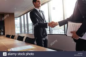 The Office The Merger Two Business Men Shaking Hands After A Successful Meeting In The