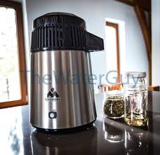 230v euro plug alcohol essential oils distiller in stainless steel black with glass carafe by megahome mh da4b sw gb pi