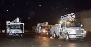 carteret craven electric co op crews head out from newport n c to