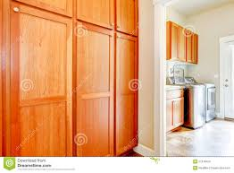 Storage Cabinet Wood Laundry Room With Wood Storage Cabinets Stock Images Image