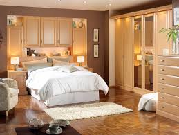 decoration beige bedroom design featuring delectable wood closet furniture units with mirror also completed with