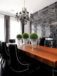 this black chandelier adds an elegant touch to a dramatic gray and black room by atmosphere interior design inc