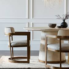 palecek dining chairs. palecek conrad dining table hand-distressed hardwood accented with antique gold metal trim on bottom palecek dining chairs