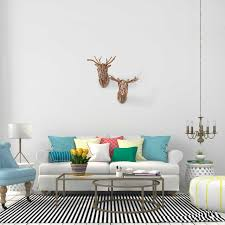 decorate the wall behind a sofa