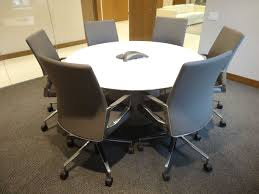 prismatique back painted glass drum base conference table with keilhauer aesync chairs