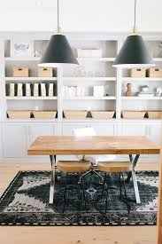 home office office wall. chic office features a wall of gray built in shelves and cabinets painted benjamin moore mindful lined with baskets gold wire magazine holders home