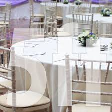 5ft round trestle table and 8 chiavari chairs
