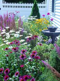 bright and airy flower garden with white fence