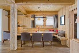 dining room bench seating: dining area with wooden walls dream vacation french alps chalet emma for a luxurious cozy